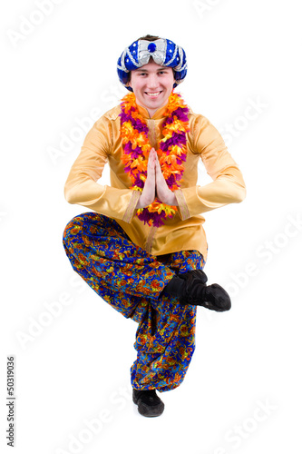 man doing yoga exercise in pose of namaste