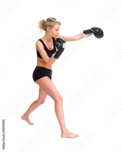Young woman with boxing gloves at workout