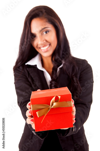 Beautiful mix race woman holding a gift over white background