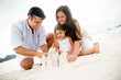 Family making sand castles