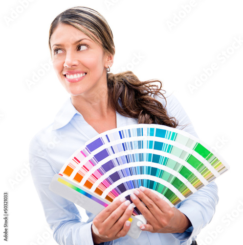 Thoughtful woman holding a color palette