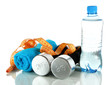 Dumbbells with centimeter,towel and bottle of water isolated