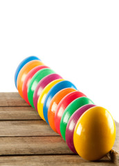 Colorful easter eggs on old wooden background.  Easter concept.