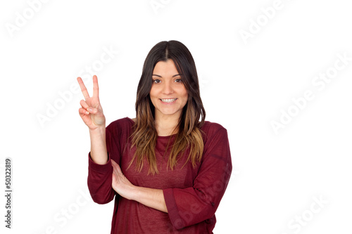 Attractive girl making the victory symbol