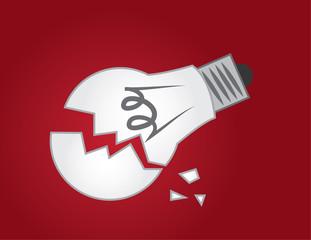 Broken light bulb on red background