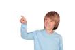 Happy preteen boy pointing something