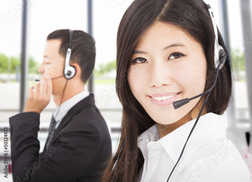 beautiful smiling businessman with call center agent