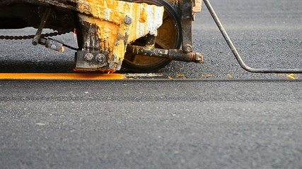 small machine paint line on road