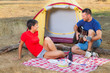 Young Couple Camping and Singing