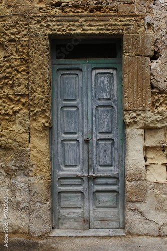 Old door and stone wall