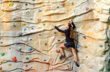 young business woman on rock wall