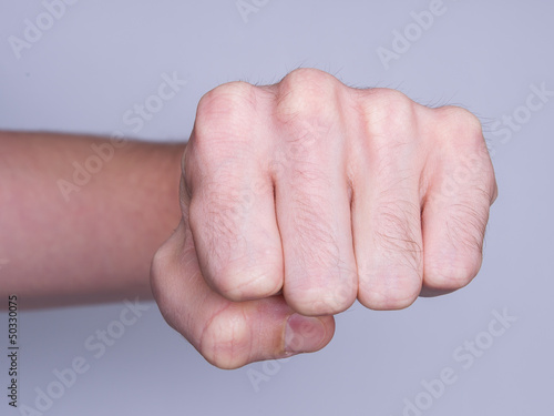 Fist of a man punching