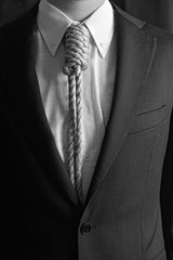 Portrait of man with loop tie