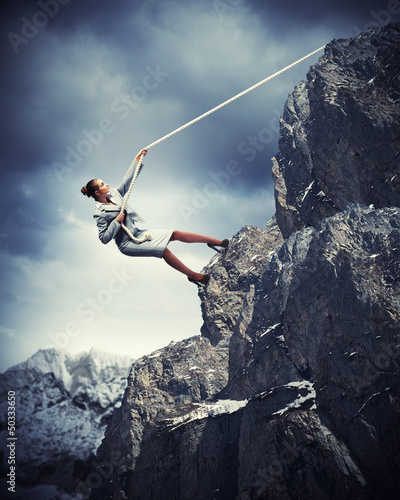 businesswoman climbing mountain - 50333650