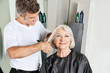 Hairdresser Cutting Senior Client's Hair