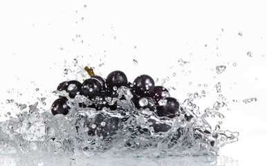 Grapes with water splash over white