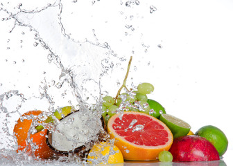 Fresh fruits with water splash isolated on white © Lukas Gojda