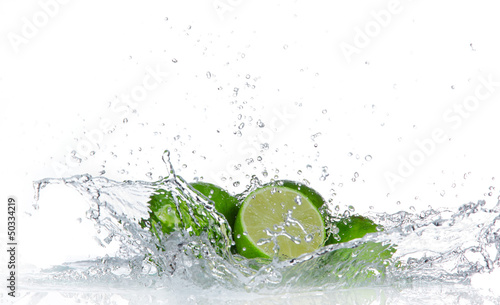 Limes with water splash isolated on white - 50334219