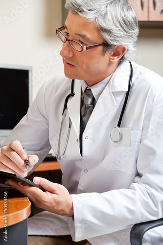 Mature Male Doctor In Clinic