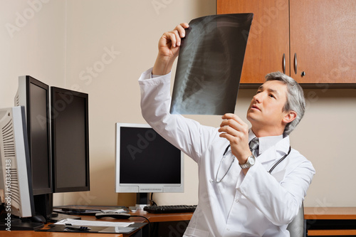 Radiologist Reviewing Shoulder X-ray