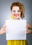 Funny woman holding empty white sign or board