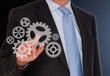 Businessman with Cogwheels