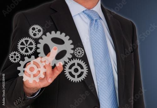 Businessman with Cogwheels