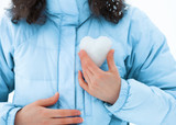 Young woman holding a snow heart at her chest poster