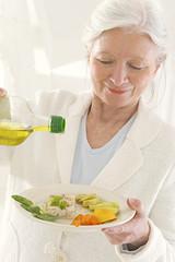 Diététique - Filet d'huile d'olive sur le poisson