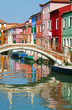 Bridge and colourful houses in Burano, Italy.