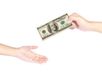 Hand handing over 100 dollar bills
