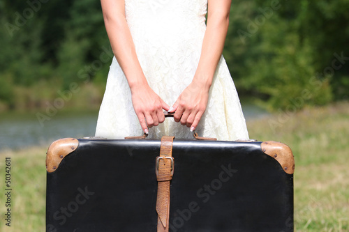 hands of a woman with a suitcase