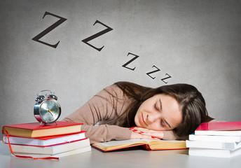 Girl sleeping on books