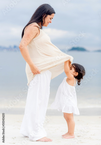 Pregnant mother and daughter