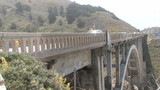 Cars passing by on Bixby Bridge Highway 1 California