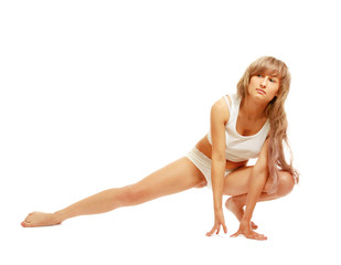 Woman in underwear in yoga pose