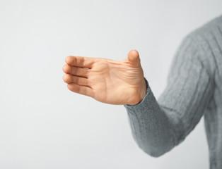man holding imaginary object
