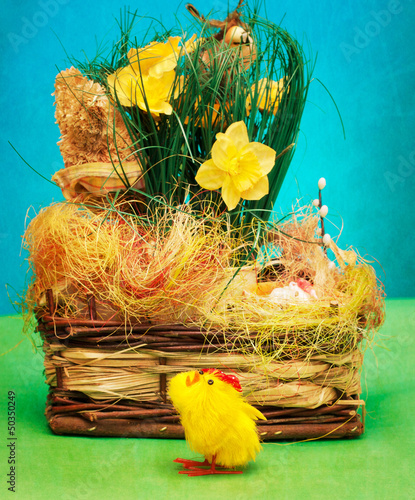 Vintage basket with easter eggs and little chicken