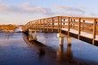 wooden bridge through frozen river