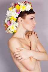 Beautiful girl with mohawk from flowers on her head