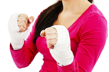 Young boxer woman with white boxing bandage on hands