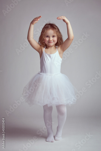 Little girl dancing like a ballerina