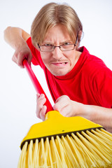 Angry man with broom