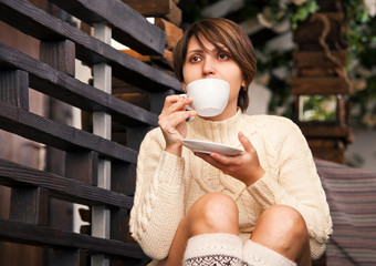 Alone girl drinks coffee at cozy home