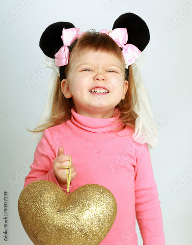 Beautiful girl with big heart, isolated on white background
