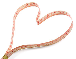 A measuring tape shaping a heart, isolated on white background
