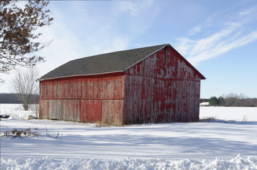 Leaning Red Barn in the Snow