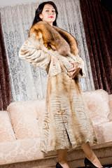 Elegant model in a long fur coat