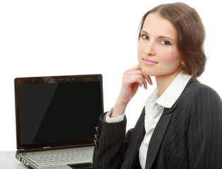 A young woman sitting with  a laptop
