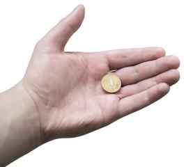 Десятирублевая монета в мужской ладони